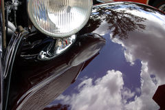 Hot rod reflections. A great paint job on the fender of this rod at a recent car show in Branosn MO USA shows some beautiful reflections of trees and the sky Stock Photos