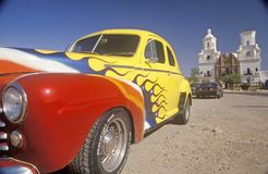 Hot Rod sits in front of Mission San Xavier del Bac, Tucson, Arizona Royalty Free Stock Image