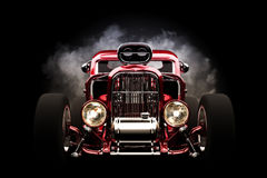 Hot rod with smoke background Stock Images