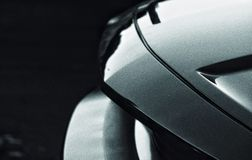 Close up black and white photo of sports car royalty free stock image