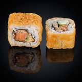 Hot roll with eel, cucumber and cream cheese Royalty Free Stock Photos