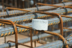 Hot rolled deformed steel a.k.a reinforcement bar and concrete spacer Royalty Free Stock Photos