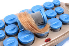 Hot rollers with blonde hair Stock Photography