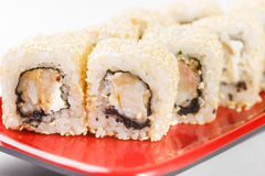 Hot rolls Nori fish sushi frying rice cheese Philadelphia California salmon. Hot rolls Nori fish sushi rolls frying rice cheese Philadelphia California salmon Stock Photo