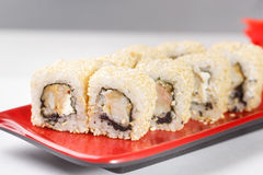 Hot rolls Nori fish sushi frying rice cheese Philadelphia California salmon. Hot rolls Nori fish sushi rolls frying rice cheese Philadelphia California salmon Royalty Free Stock Images