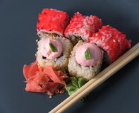 Hot rolls with wasabi and ginger in sesame. Tasty rolls with wasabi and ginger in sesame Stock Photography
