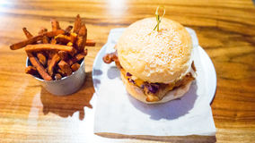 Hot Rubbed Chicken Burger With Sweet Potato Fries Royalty Free Stock Photography