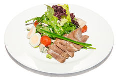 Hot salad with boiled beef tongue Royalty Free Stock Photo
