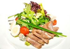 Hot salad with boiled beef tongue Royalty Free Stock Photography