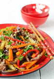 Hot salad with eggplant, beef and pepper. Asian cuisine. Hot salad with eggplant, beef and pepper Royalty Free Stock Image