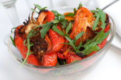 Hot salad from grilled peppers with fresh arugula Stock Photo