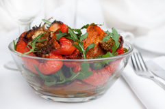 Hot salad from grilled peppers with fresh arugula Royalty Free Stock Photos