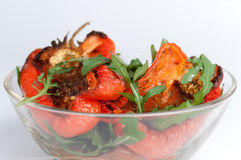 Hot salad from grilled peppers with fresh arugula Royalty Free Stock Photography