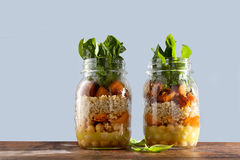 Hot Salad from roasted Pumpkin, Chickpeas, carrots, quinoa, and Royalty Free Stock Photography