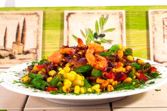 Hot salad with shrimp, corn, green beans, red onion, stewed, fried, Italian kitchen, tiles, Provence Royalty Free Stock Images