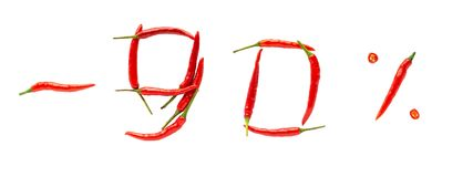 Hot sale or discount concept. Writing made of fresh chilli peppers on white background. Ninety percent discount rate stock image