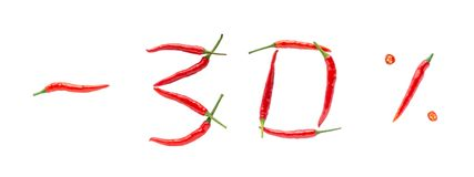 Hot sale or discount concept. Writing made of fresh chilli peppers on white background. Thirty percent discount rate stock images