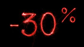 Hot Sale 30 percent off. Made with red sparklers on black background Stock Image