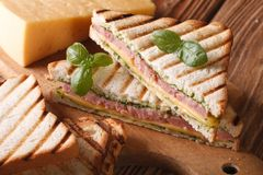Hot sandwich with ham, cheese and basil close-up royalty free stock photo