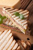 Hot sandwich with ham, cheese and basil close-up, vertical Stock Photo