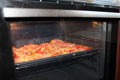 Hot sandwiches cooking in the kitchen-range Royalty Free Stock Photography