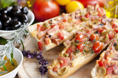 Hot sandwiches with ham and olives Stock Images