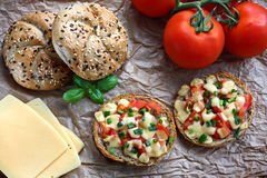 Hot sandwiches. Healthy sandwiches with wholegrain bread rolled, tomatoes and cheese Royalty Free Stock Photos