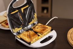 Hot sandwiches in a sandwich maker royalty free stock photos