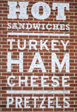 Hot Sandwiches Sign. A vintage advertisement painted in white on a brick wall Stock Photo