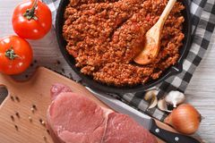 Hot sauce bolognese and fresh ingredients horizontal top view Royalty Free Stock Photos