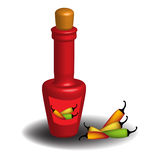 Hot sauce bottle. And colorful hot peppers Royalty Free Stock Photography