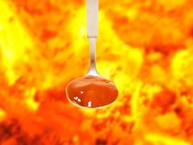Hot sauce in a spoon Stock Photo