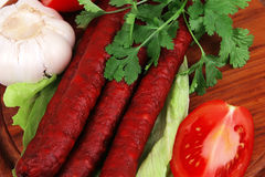 Hot sausages on platter Royalty Free Stock Photo