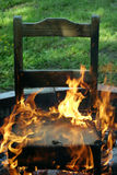 In The Hot Seat. A chair on fire... metaphor In The Hot Seat Royalty Free Stock Photography