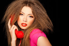 Hot sensual call girl talking on red phone Royalty Free Stock Photography
