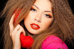 Hot sensual woman talking on red phone Stock Images