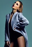Hot sexy blond model in overcoat Royalty Free Stock Images