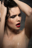 Hot sexy brunette woman in water studio, dark Royalty Free Stock Photography