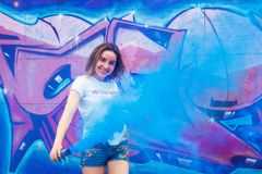 Crazy and boring girlfriend in white tshirt and jeanse short with a smoke bomb stock photography