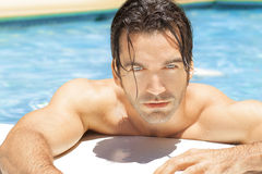 Hot sexy guy in pool Stock Images
