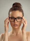 Hot sexy naked woman wearing glasses Stock Photos