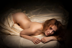 Hot sexy woman with perfect body lying naked in bed Royalty Free Stock Image