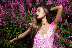 Hot sexy woman in pink dress with flowers Royalty Free Stock Image