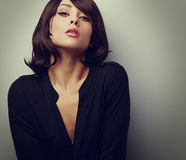 Hot sexy woman with short hair posing in black shirt. Vintage Stock Photos