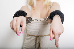 Hot sexy woman with string shirt and black handcuffs Stock Photos