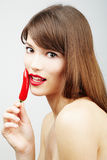 Hot Sexz Woman Holding A Chili Pepper Royalty Free Stock Photography