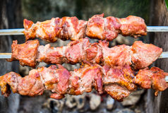Hot shish kebab on metal skewers Royalty Free Stock Image
