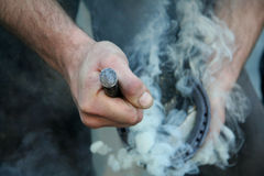Hot shoeing the horse Stock Images
