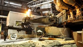 Hot shop of the metallurgical plant with modern machinery, industrial landscape. Stock footage. Molten metal production. Hot shop of the metallurgical plant with royalty free stock photos