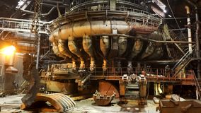 Hot shop of the metallurgical plant with modern machinery, industrial landscape. Stock footage. Molten metal production. Hot shop of the metallurgical plant with stock image